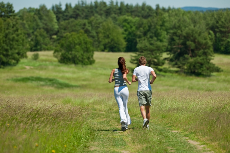 young-couple-jogging-outdoors-in-spring-nature